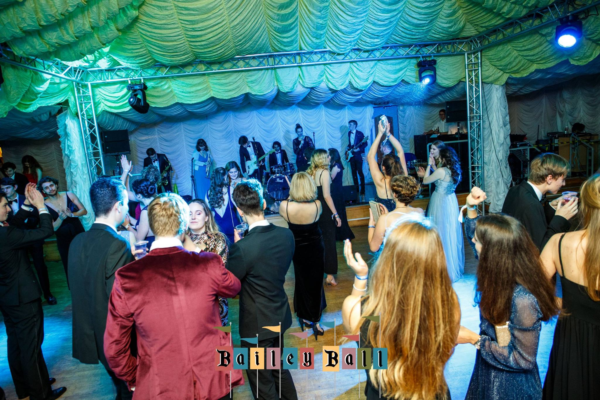 A photo of Bailey Ball 2018, showing live music and people dancing.